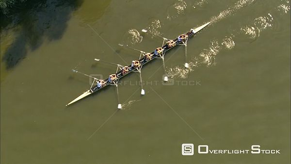 Sculling crew in training on the River Dijver in Bruges, Belgium
