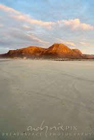 Muizenberg Peak viewed from Muizenberg Beach, sunrise