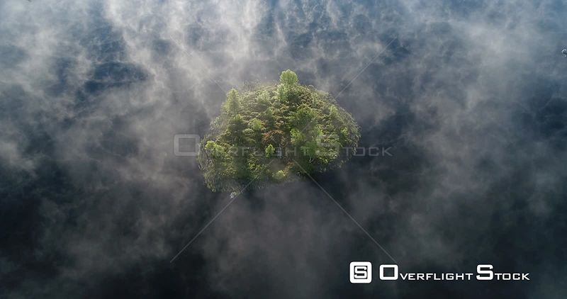Aerial shot of mist over a mountain lake, Golsfjellet, Buskerund, Norway, October 2017.