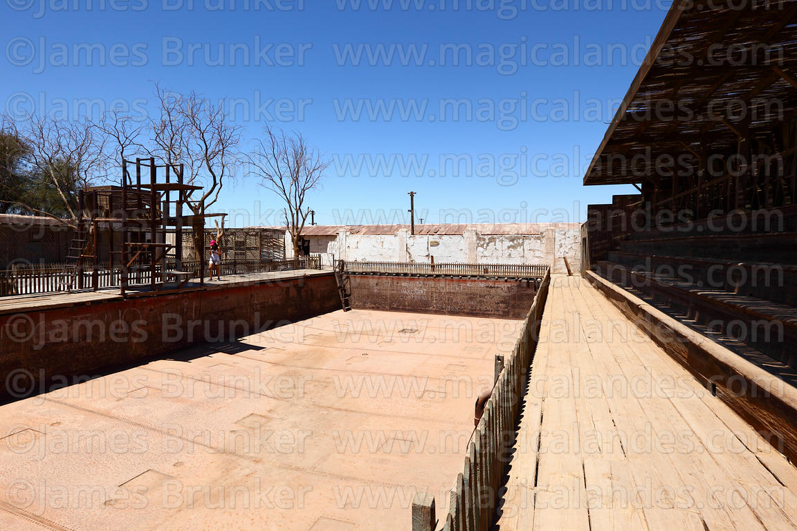 Empty swimming pool in abandoned nitrate mining town of Humberstone, Region I, Chile