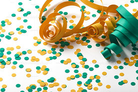 Carnival background with confetti and green and yellow serpentine spaced on white background