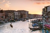 Romantic sunset on Grand canal and gondola, Venice, Italy