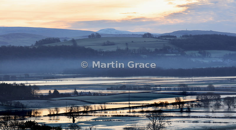 Flooded and misty Lyth Valley reflecting a weak December sunrise,  English Lake District