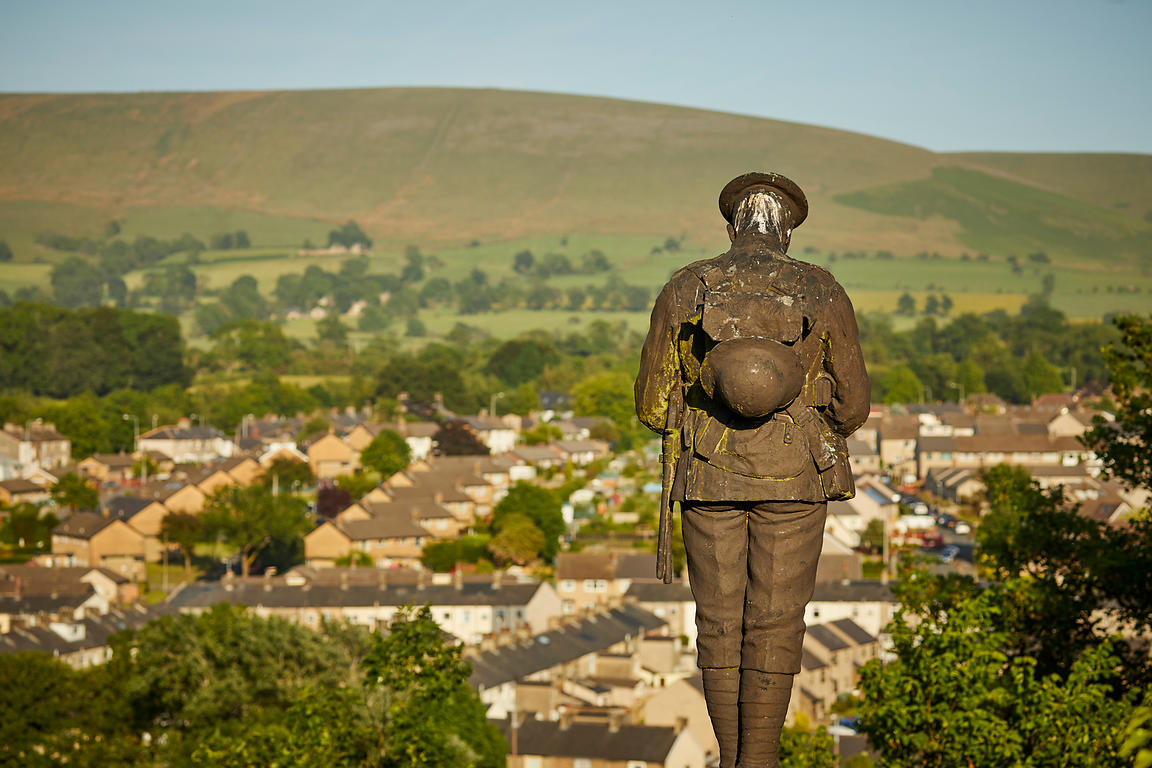 The war memorial with Pendle Hill