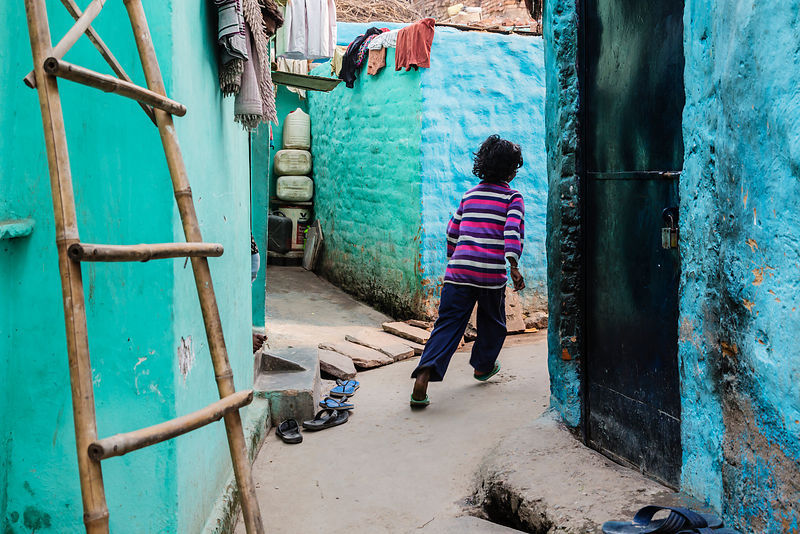 Child Running in Alleyway in Shanty