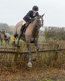 Katie Robinson jumping a hedge near Pasture Lane