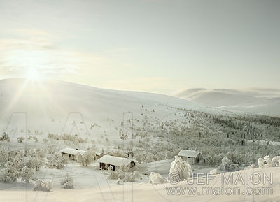 Wilderness huts in snowcapped landscape