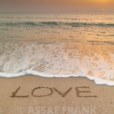 Sand writing - Word Love written on beach