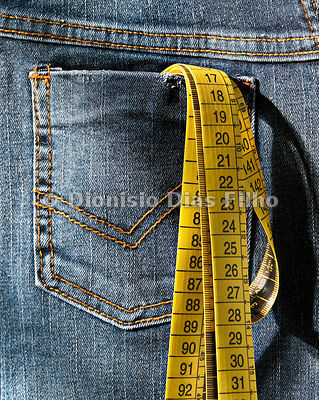 Detail of jeans pocket with measuring tape