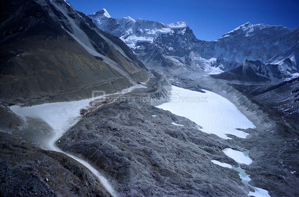 NEPAL Imja Glacier -- 16 Apr 2005 -- Aerial view of the Imja Glacier and the lake that has formed upon it which is a sign of ...