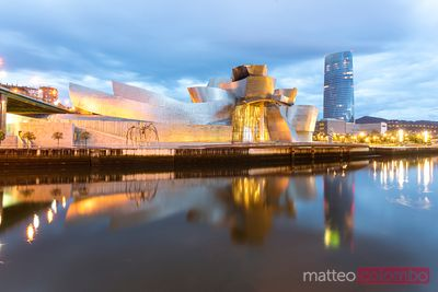 Guggenheim museum reflected in river, Bilbao, Spain