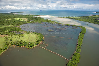 Aerial view of river mouth, coast and fish / shrimp farm, Camarines Sur, Pacific Coast, Luzon, Philippines fish or shrimp far...
