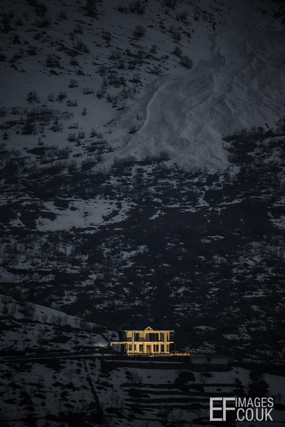 A Mansion Lit Up At Dusk, On A Mountain Side In Iraq
