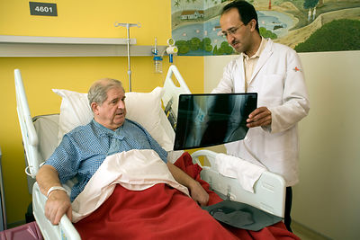 India - Gurgaon - Dr Raj Gopal, an orthopaedic surgeon talks to Mr Dronot, 68 from the USA, before his operation