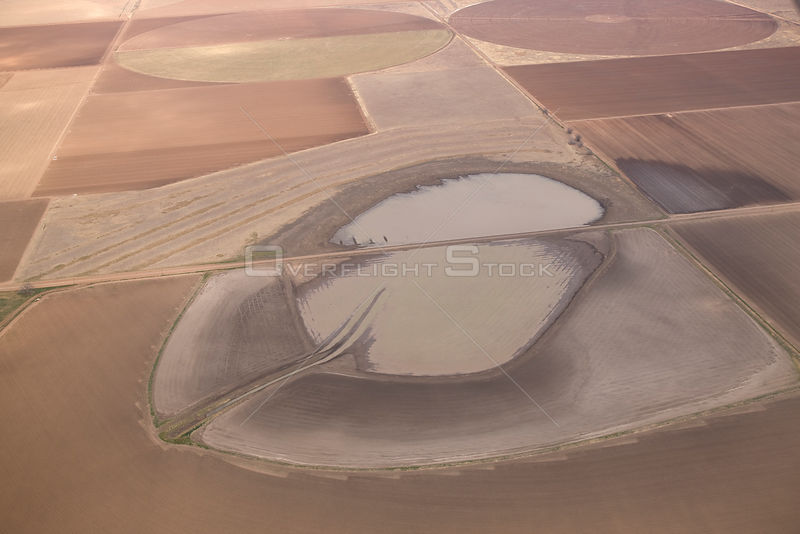 Aerial view of temporary lake (playa) in monoculture crop fields, high plains of Texas, USA