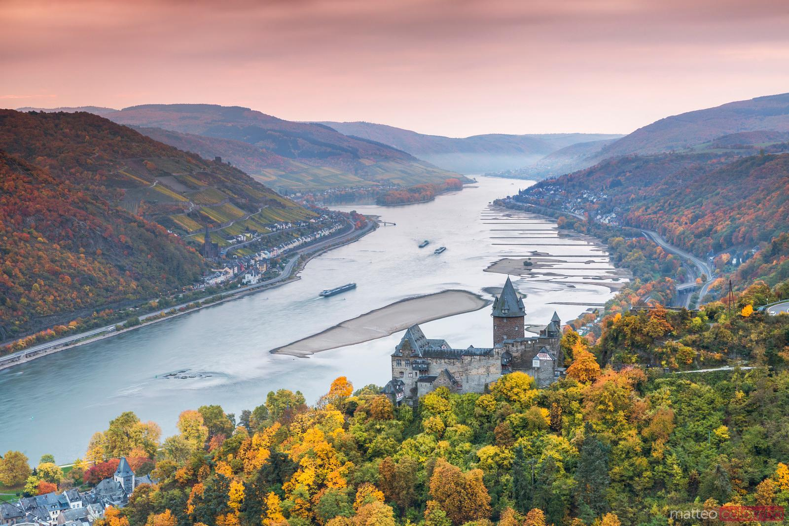 Burg Stahleck and river Rhine in autumn at sunrise, Germany
