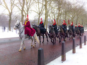 Royal Horse Guards Cavalry parade in snow, London, UK