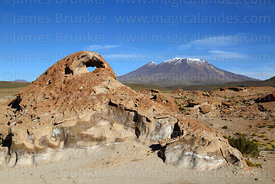 Eroded volcanic rock formation and Cerro Caquella volcano, Nor Lípez Province, Bolivia