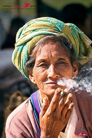 Portrait of old tribal woman smoking cigar, Myanmar