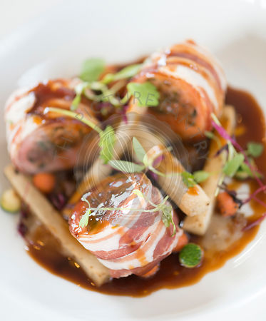 Baked loin of rabbit and pancetta. Chestnut and sage stuffing, shallot puree and Dijon mustard sauce.