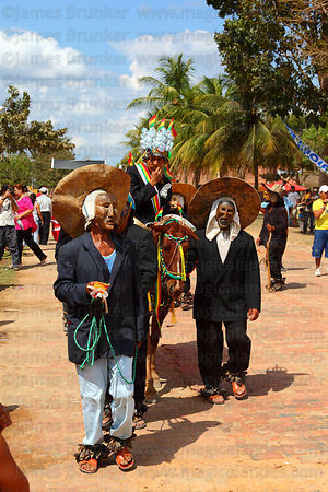 Achus leading their king (who is riding a cow) during festival parade, San Ignacio de Moxos, Bolivia