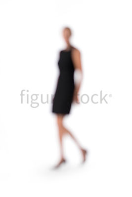 An abstract image of a walking blonde woman in a little black dress – shot from mid level.