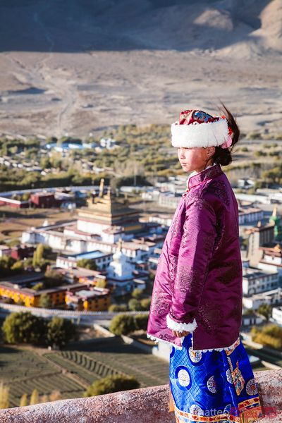 Young local girl looking at Samye monastery, Tibet