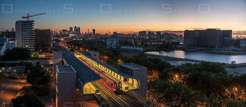 Dusk Sunset Panoramic of Pontoon Dock and Commuter Train Station London England