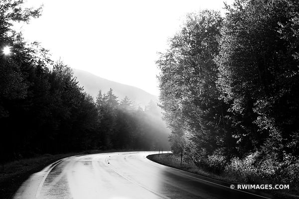 SUNSET KANCAMAGUS PASS ROAD BEND WHITE MOUNTAINS DRIVING KANCAMAGUS HIGHWAY NEW HAMPSHIRE BLACK AND WHITE