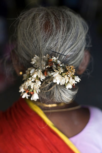 India - Cuddalore - Flowers in a woman's hair in the Tamaraikulum Elders's Village
