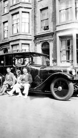 NOT FOR MISERY MEMOIR USAGE - An old family photograph of people in front of an old car in Morcombe, England in 1929.