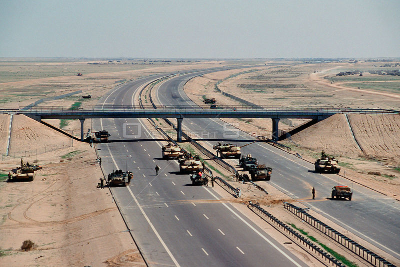 KUWAIT -- 03 Mar 1991 -- US Army M-1A1 Abrams main battle tanks guard a checkpoint along Highway 8 during Operation Desert Storm