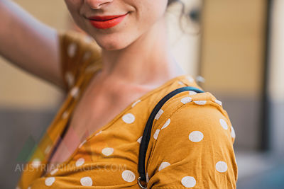 Beautiful woman wearing yellow dress with polka dots