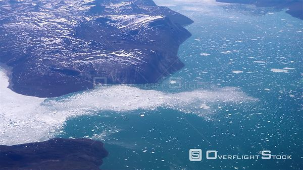 Glacier emptying sea ice into fjords, Greenland