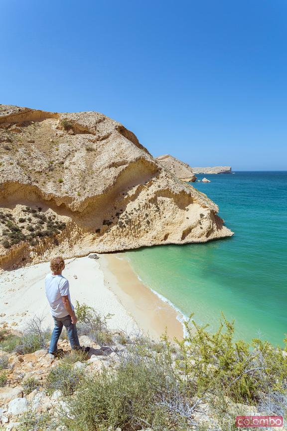 Tourist looking at coast and sea near Muscat, Oman