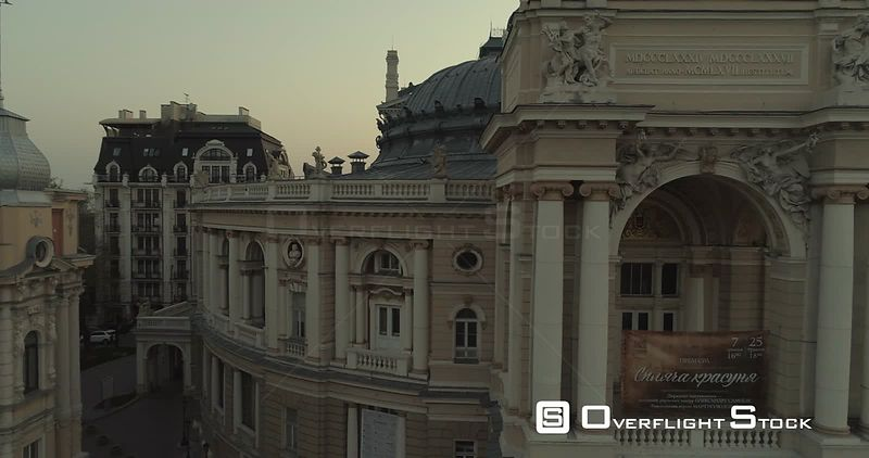 Aerial camera tracks slowly pass the upper level of Odessa Opera Theatre at sunrise Ukraine