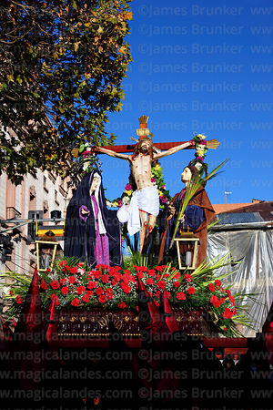 Penitents carrying statue of Jesus on the cross / Paso del Calvario during Good Friday procession, Plaza Murillo, La Paz, Bol...