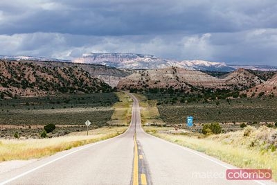 Road with dark clouds, Utah, USA