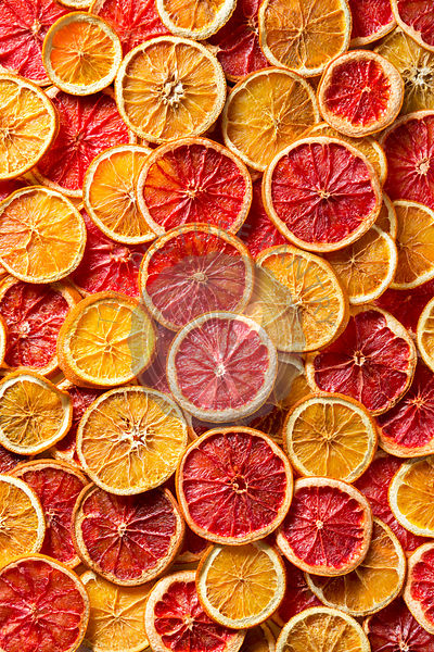 Dried orange and grapefruit slices background
