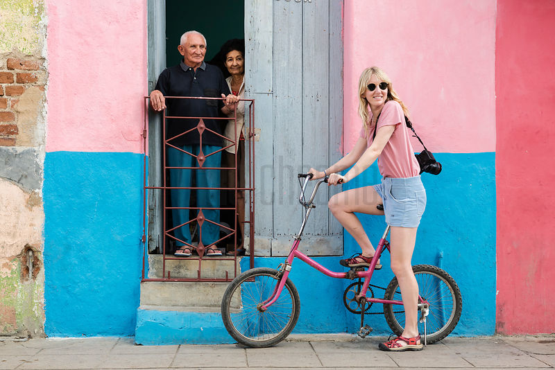 Young Woman on a Pink Bicycle