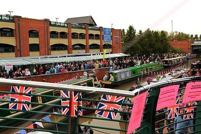 Union Jack Flags with Thousands of Visitors Visiting Stalls at the Banbury Canal Day