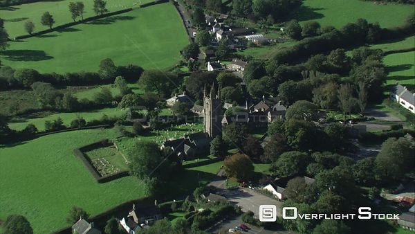 Aerial view tracking over WidecombeintheMoor village church, Dartmoor National Park, Devon, England, UK, October 2015.