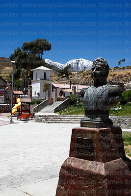 Statue of General Bernardo O'Higgens Riquelme in main square, San Ildefonso church and Nevados de Putre / Taapaca volcano in ...