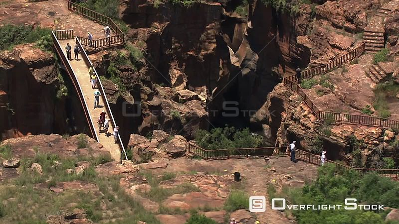 Aerial shot of people admiring the Bourke's Luck potholes North West South Africa