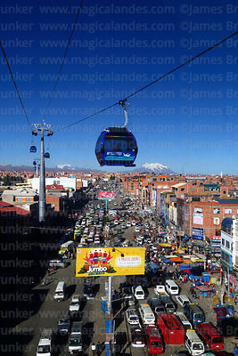 Blue Line cable car cabin with Mar para Bolivia / Sea for Bolivia slogan on it above traffic jams in Rio Seco, El Alto, Bolivia