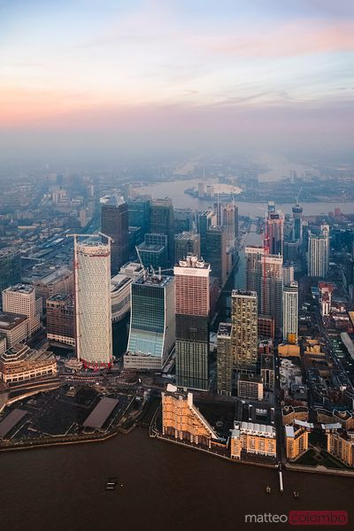 Aerial view of Canary Wharf towers at sunset, London