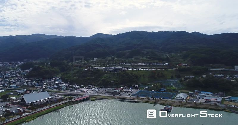 Drone shot of Lake Suwa & Kiso Mountains. Nagano Japan