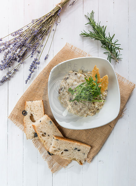 Mushroom risotto served with Focaccia bread.