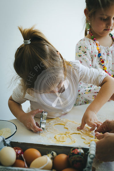 Sisters making cookies