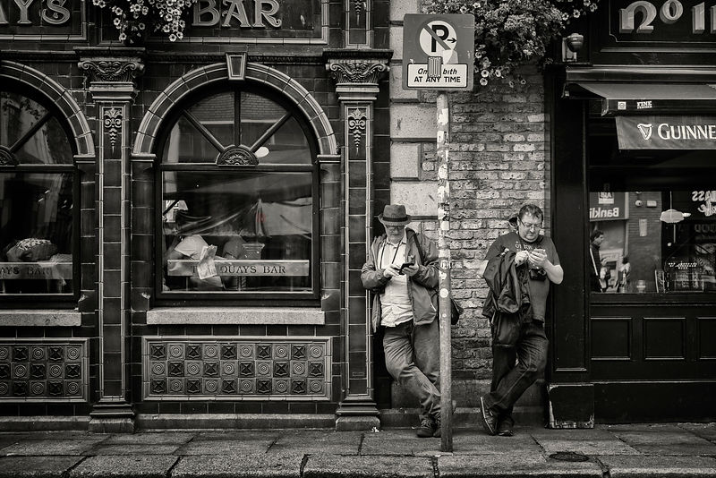 Street Photographers Martin J Murphy and Peter O'Doherty Taking a Break